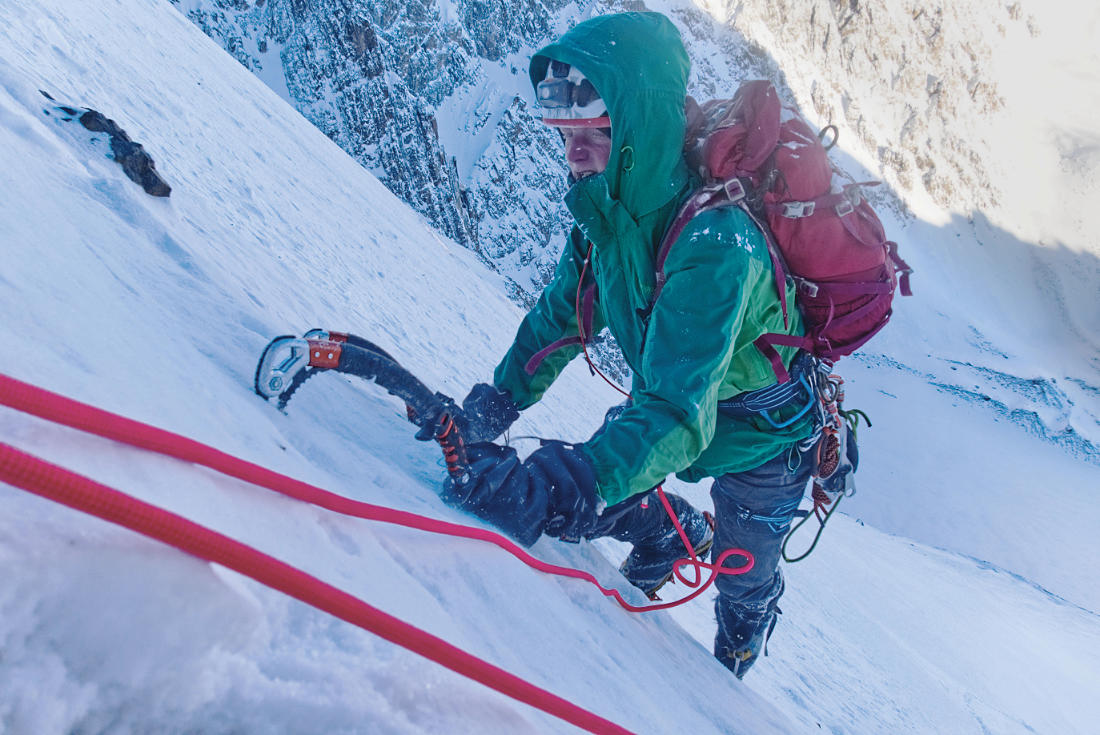 Grisha Schukin climbs steep snow in the lower part of the face